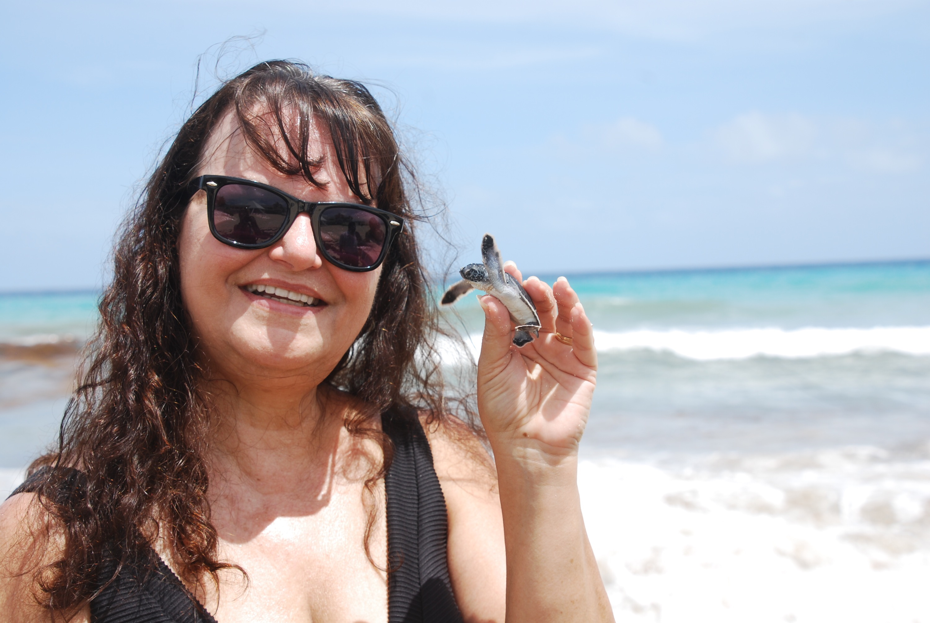 Thats me holding a newly hatched sea turtle found on the beach in Cancun! what a wonderful experience! Photo copyright Valerie Duty Citrano