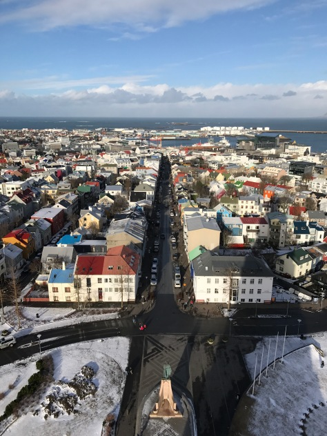 Reykjavik from the bell tower of Hallgrimskirkja Church with the statue of Leif Eiriksson below