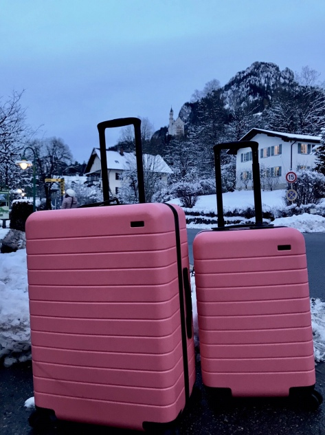 My Away luggage with Neuschwanstein Castle on the mountain